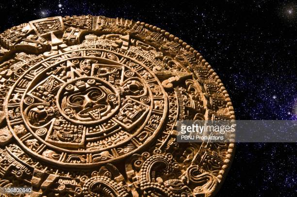 aztec calendar stone carving in space - calendar icon stock photos and pictures