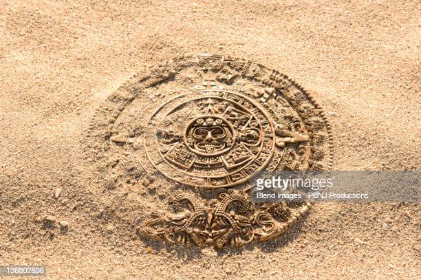 aztec calendar stone carving on sand - latin american civilizations stock photos and pictures