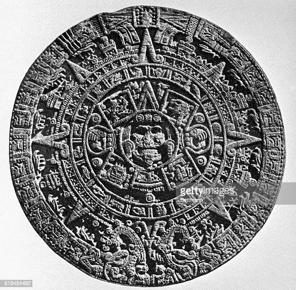 Aztec Calendar Stone Middle The Sun Face inner Circle the 4 precosmic periods of the world Middle Ring The 20 signs of the day with rays and the 2...