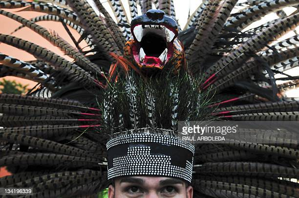 Aztec dancer performs during a celebration of the our Lady Zapopan as part of the Pan american games in Tlaquepaque Jalisco state Mexico on October...