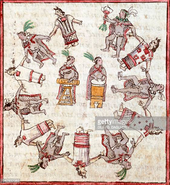Aztec dancing to the rhythm of drums illustration taken from the History of the Indies by Diego Duran 1579 manuscript folio 305 Madrid Biblioteca...