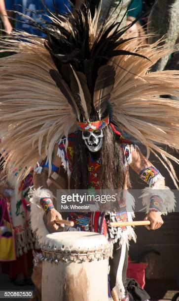 aztec day of the dead drummer plays in olvera street in downtown los angeles, california - aztec mask stock pictures, royalty-free photos & images