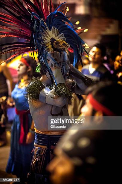 aztec finishing to dance in mixquic downtown - aztec civilization stock photos and pictures