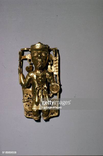 Aztec Gold Pendant of a Ruler with ritual regalia Mixtec 12001521 He holds a serpentstaff battleaxe and a shield A mask hangs from his lipring...