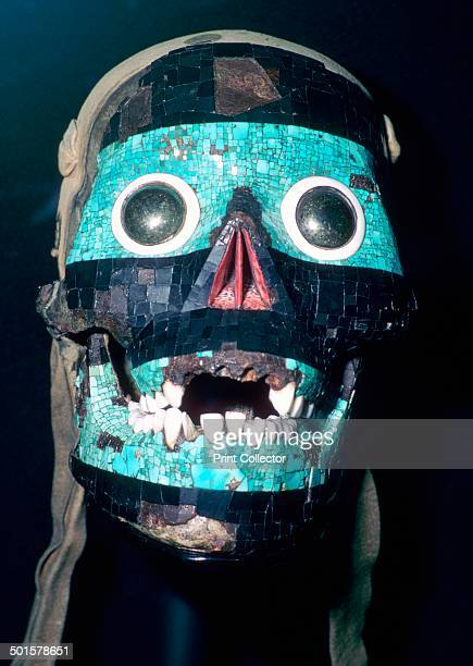 Aztec mask believed to represent Tezcatlipoca modelled on a skull with the back cut away and lined with leather 15th to 16th century The jaw is...