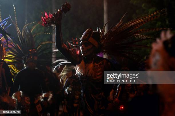 Aztec ritual dancers perform at Hollywood Forever Cemetery's 19th annual Dia De Los Muertos celebration in Hollywood California on October 27 2018...