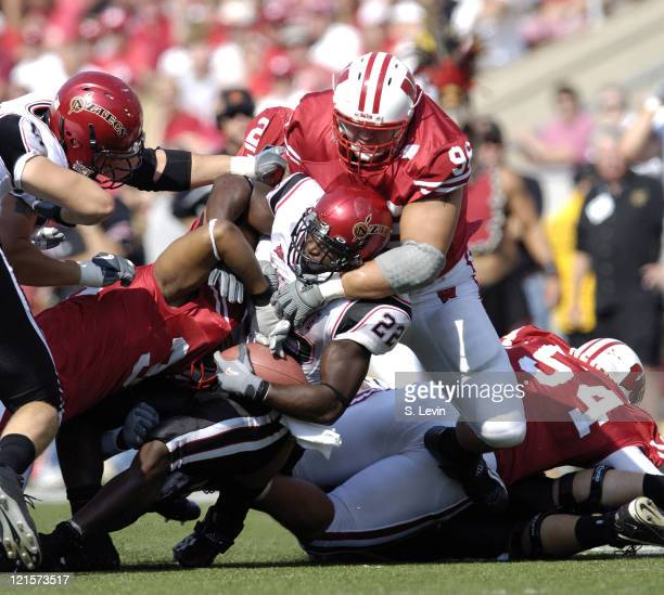 Aztec running back Lynell Hamilton is stopped by the Badger defense during the game between the Wisconsin Badgers and the San Diego State Aztecs at...