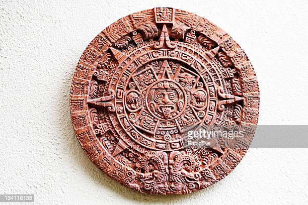 aztec stone of the sun plaque  hung on wall - aztec civilization stock photos and pictures