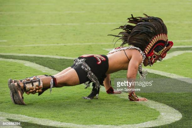Aztec Warrior mascot celebrates a touchdown with pushups during the college football game between UC Davis Aggies and San Diego State University...