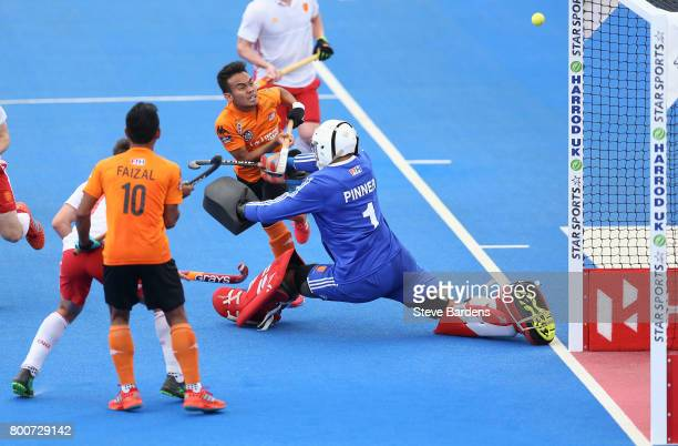 Azuan Hasan of Malaysia has a shot saved by George Pinner of England during the 3rd/4th place match between Malaysia and England on day nine of the...