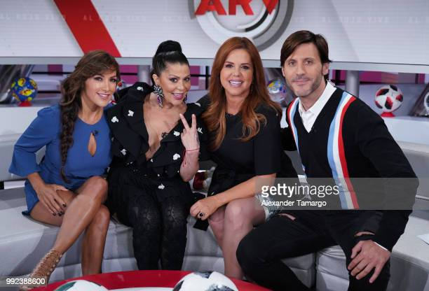Azucena Cierco Alejandra Guzman Maria Celeste Arraras and Quique Usales are seen on the set of 'Al Rojo Vivo' to promote La Voz at Telemundo Center...
