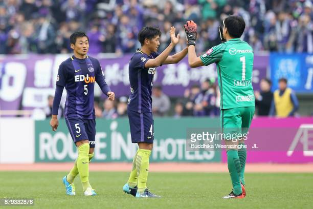 K azuhiko Chiba Hiroki Mizumoto and Takuto Hayashi of Sanfrecce Hiroshima celebrate their 21 victory and avoid the relegation to the J2 after the...