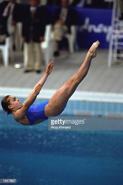 Azul Almazan of Mexico performs her dive in Women's 3m Springboard during the Sydney 2000 Olympic Games on September 27,2000 at the Sydney Aquatic...