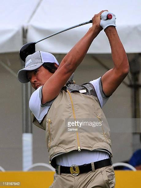 Azuma Yano hits a tee shot on the first hole during the third round of the Tsuruya Open at Yamanohara Glof Club on April 23, 2011 in Kawanishi,...