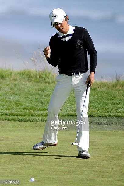 Azuma Yano of Japan celebrates a putt on the ninth green during the first round of the 110th U.S. Open at Pebble Beach Golf Links on June 17, 2010 in...