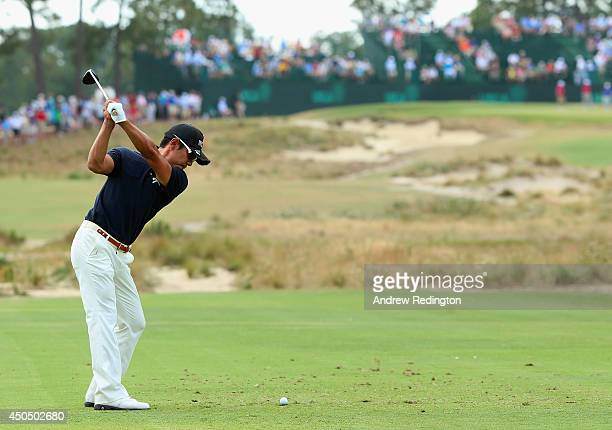 Azuma Yano of Japan hits his tee shot on the 13th hole during the first round of the 114th U.S. Open at Pinehurst Resort & Country Club, Course No. 2...