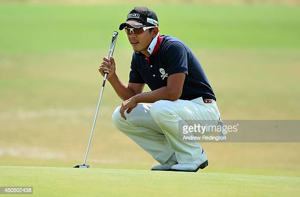 Azuma Yano of Japan lines up his putt on the 11th hole during the first round of the 114th U.S. Open at Pinehurst Resort & Country Club, Course No. 2...