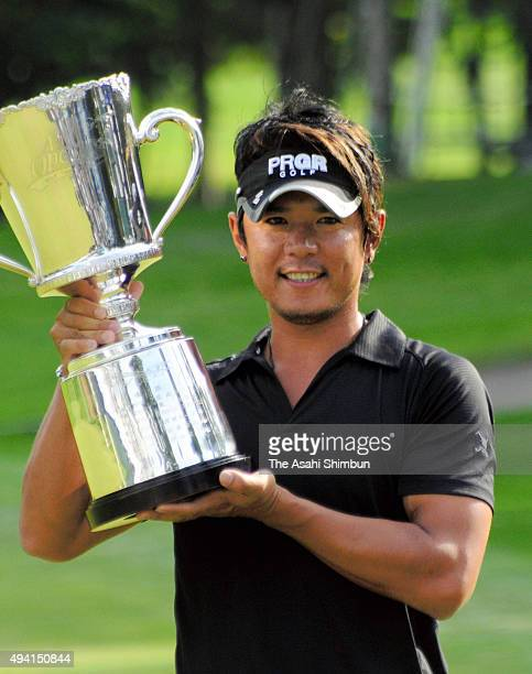 Azuma Yano of Japan poses with the trophy after winning the ANA Open at Sapporo Golf Club Wattsu Course on September 19, 2008 in Kitahiroshima,...
