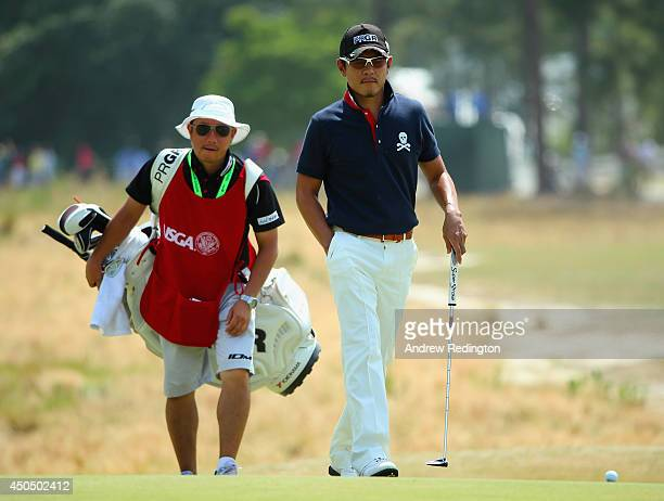 Azuma Yano of Japan walks with his caddie on the 12th hole during the first round of the 114th U.S. Open at Pinehurst Resort & Country Club, Course...