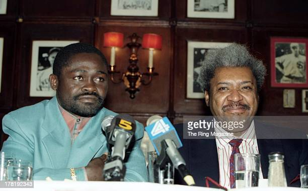 Azumah Nelson and Promoter Don King look on during a press conference