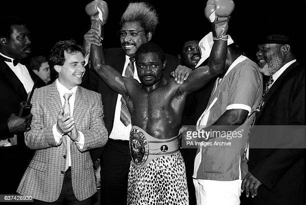 Azumah Nelson celebrates with manager Don King after retaining his World title in twelve rounds