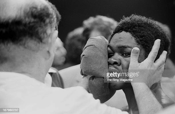 Azumah Nelson gets checked by his trainer during the fight against Salvador Sanchez during the fight at Madison Square Garden on July 21 1982 in New...