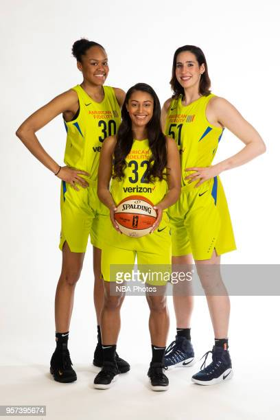 Azura Stevens Loryn Goodwin and Natalie Butler of the Dallas Wings pose for a portrait during Dallas Wings Media Day at Bankers Life Fieldhouse on...