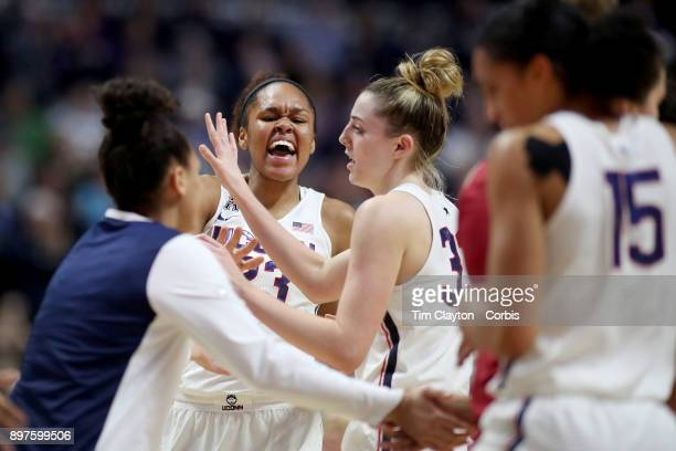 Azura Stevens of the Connecticut Huskies and Katie Lou Samuelson of the Connecticut Huskies react to a basket as a time out is called during the...