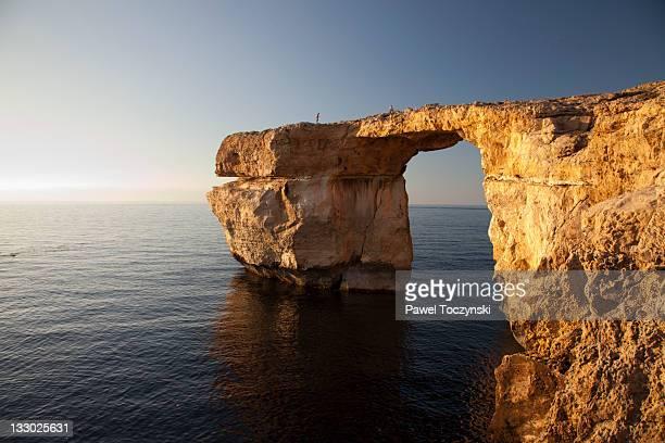 azure window, dwejra bay on gozo island - dwejra stock-fotos und bilder