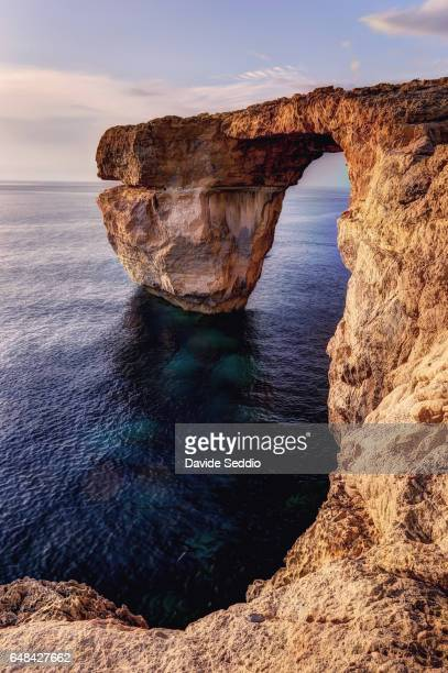 azure window, natural arch in gozo - dwejra stock-fotos und bilder