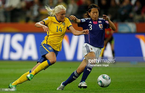 Azusa Iwashimizu of Japan and Josefine Oeqvist of Sweden battle for the ball during the FIFA Women's World Cup Semi Final match between Japan and...