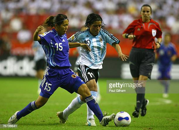 Azusa Iwashimizu of Japan battles for the ball with Analia Almeida of Argentina during the FIFA Women's World Cup 2007 Group A match between...