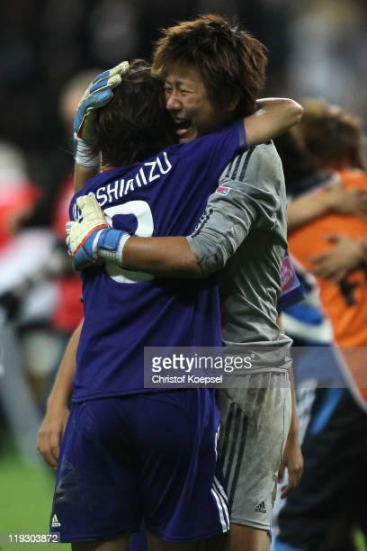 Azusa Iwashimizu of Japan embraces Ayumi Kaihori of Japan after winning the FIFA Women's World Cup Final match between Japan and USA at the FIFA...