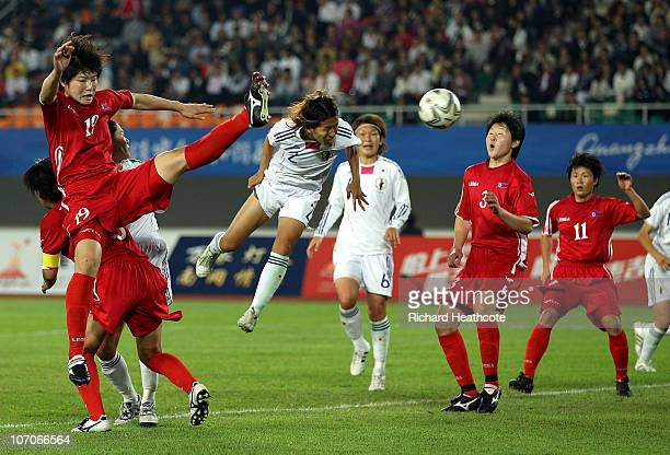 Azusa Iwashimizu of Japan heads the ball into the net in the second half against North Korea during the women's gold medal football match at Tianhe...
