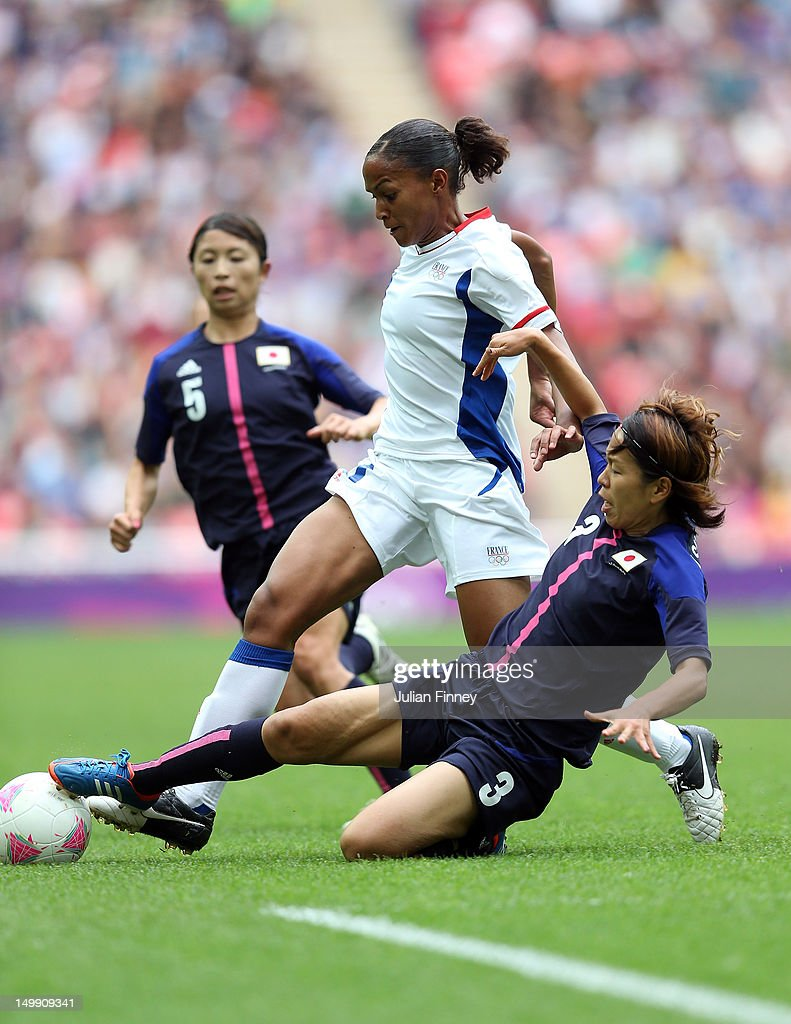 Azusa Iwashimizu of Japan tackles Marie-Laure Delie of France during the Women's Football Semi Final match between France and Japan on Day 10 of the London 2012 Olympic Games at Wembley Stadium on August 6, 2012 in London, England.
