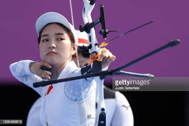 Azusa Yamauchi of Team Japan competes in the Women's Team quarterfinals on day two of the Tokyo 2020 Olympic Games at Yumenoshima Park Archery Field...