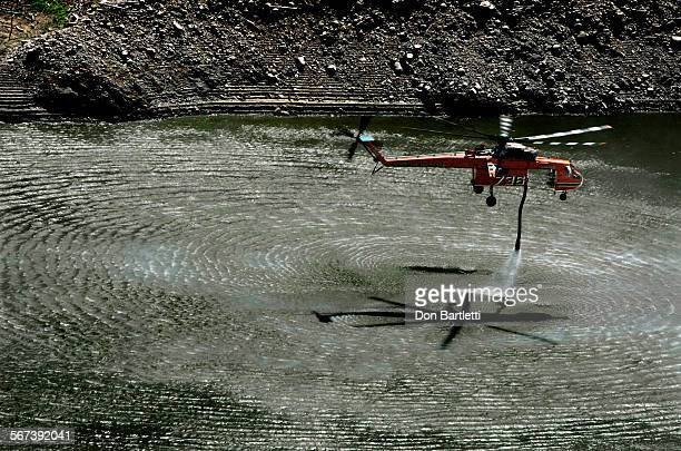 AUGUST 18 2014 Azuza CA A firefighting helicopter reloads with water from the San Gabriel Reservoir near Azuza CA on Aug 18 2014 while fighting the...
