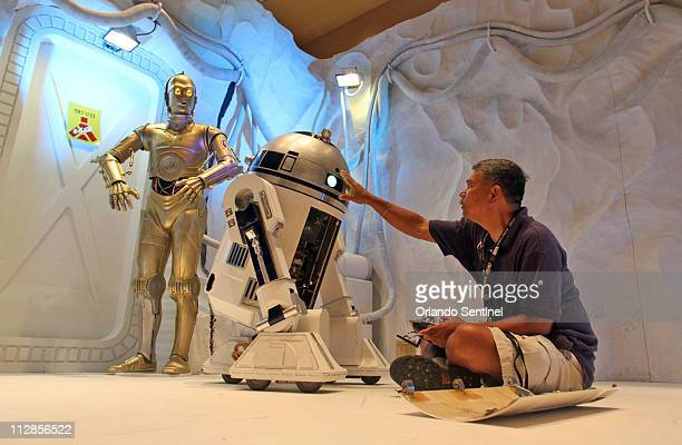 Azwan Sugi right of Greeley Colorado works on a R2D2 droid he built This droid was used in the movie Fan Boys Sugi is attending Star Wars Celebration...