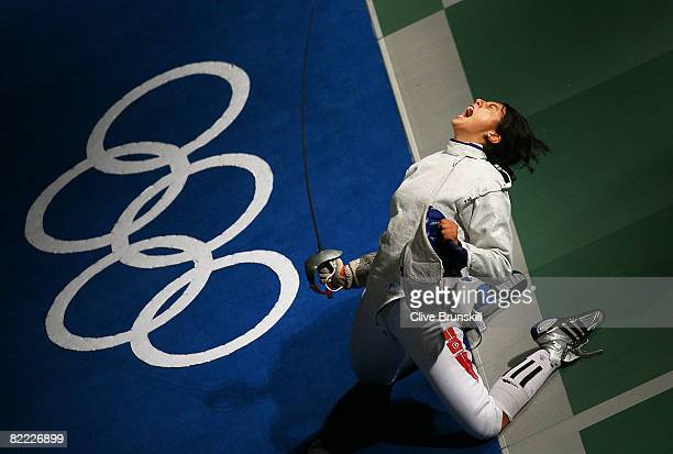 Azza Besbes of Tunisia celebrates winning in the Saber Round of 16 in the fencing event held at the Fencing Hall of National Convention Center during...