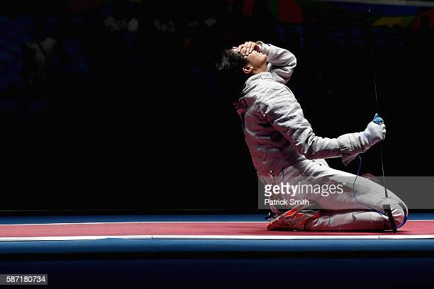 Azza Besbes of Tunisia reacts after losing to Manon Brunet of France during the Women's Individual Sabre on Day 3 of the Rio 2016 Olympic Games at...