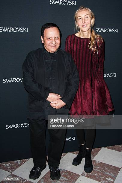 Azzedine Alaia and Carla Sozzani attend the Swarovski Dinner In Honor of the Bouroullec Brothers at Chateau de Versailles on November 14 2013 in...