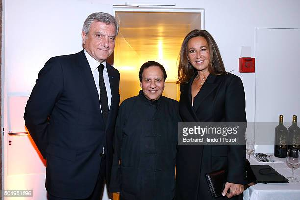 Azzedine Alaia standing between CEO Dior Sidney Toledano and his wife Katia Toledano attend the 'Jean Nouvel and Claude Parent Musees a venir'...