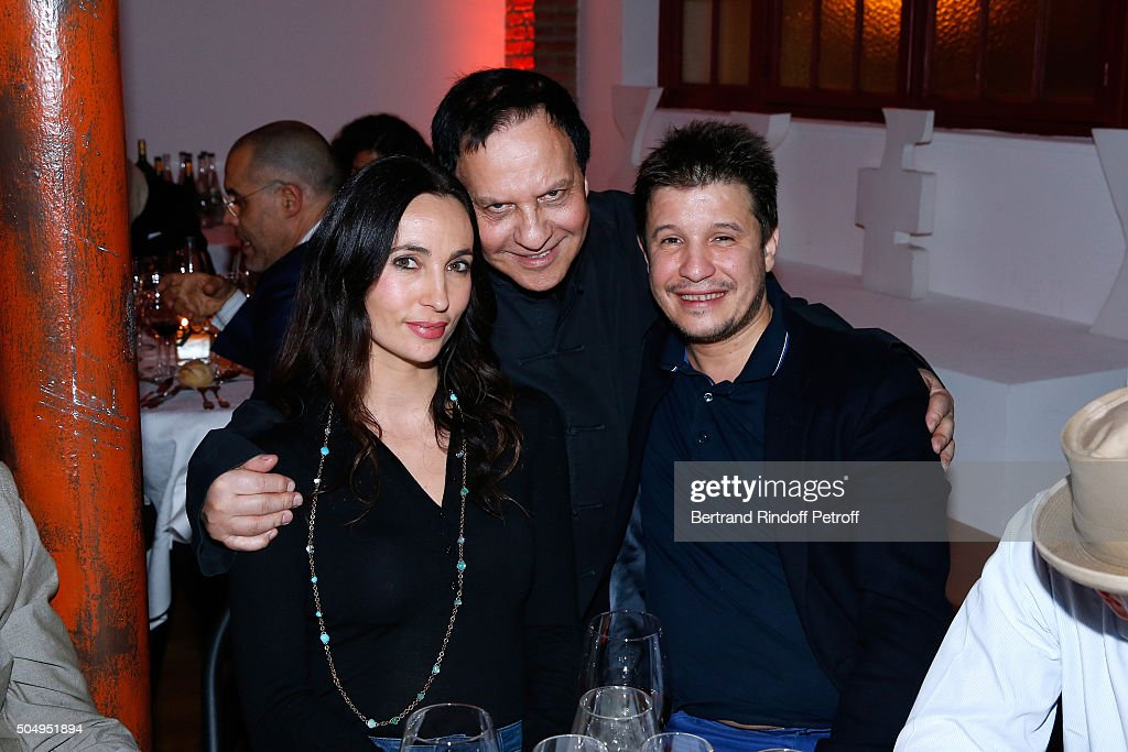 Azzedine Alaia standing between Contemporary artist Adel Abdessemed and his wife Julie attend the 'Jean Nouvel and Claude Parent, Musees a venir' Exhibition Opening at Galerie Azzedine Alaïa on January 13, 2016 in Paris, France.