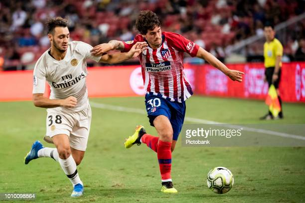 Azzedine Toufiqui of Paris Saint Germain fights for the ball with Roberto Olabe of Club Atletico de Madrid during the International Champions Cup...
