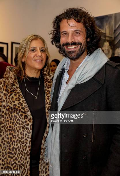 Azzi Glasser and Christian Vit attend a private view of Come As You Are by photographer Debbi Clark in support of the Sir Hubert von Herkomer Arts...