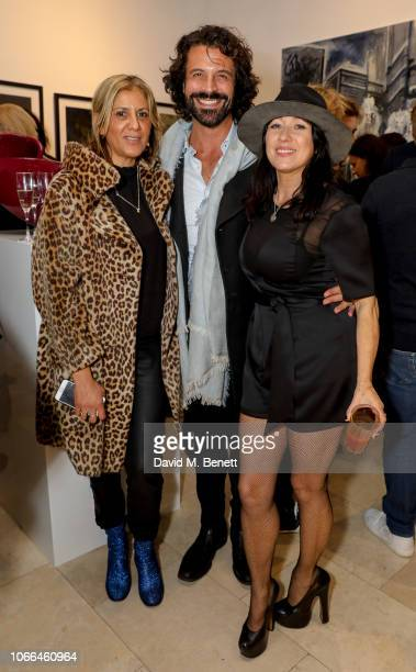 Azzi Glasser Christian Vit and Debbie Clark attend a private view of Come As You Are by photographer Debbi Clark in support of the Sir Hubert von...