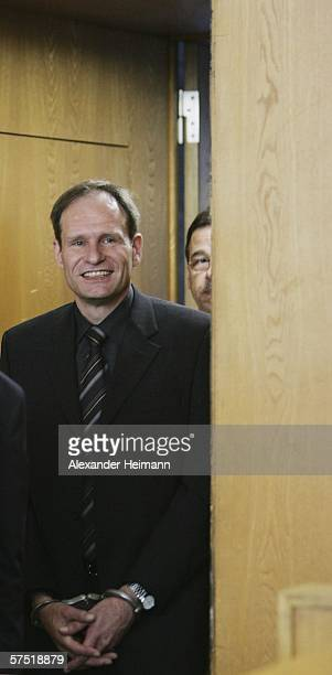 b Germany's selfconfessed cannibal Armin Meiwes enters the courtroom for his retrial for murder on 03 May 2006 at court in Frankfurt Germany in which...