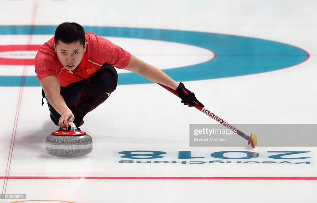 Ba Dexin of China delivers a stone against Switzerland in the Curling Mixed Doubles Round Robin Session 1 during the PyeongChang 2018 Winter Olympic Games at Gangneung Curling Centre on February 8, 2018 in Pyeongchang-gun, South Korea.