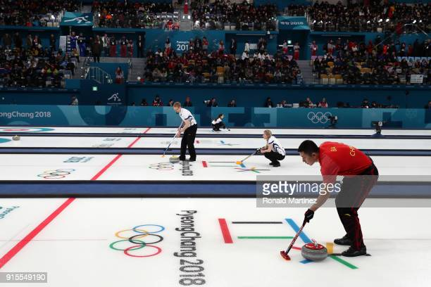 Ba Dexin of China sweeps the ice against Switzerland in the Curling Mixed Doubles Round Robin Session 1 during the PyeongChang 2018 Winter Olympic...