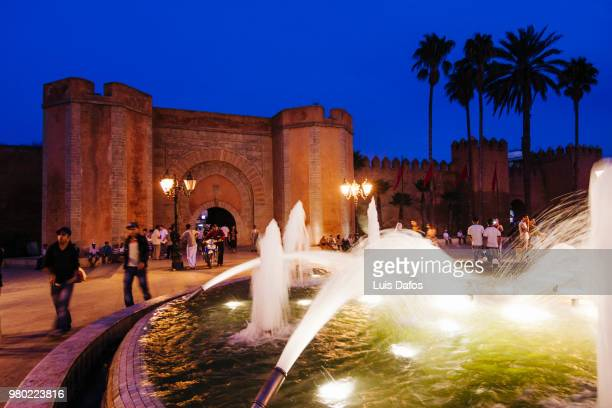 Bab el-Had medina gate illuminated at night.